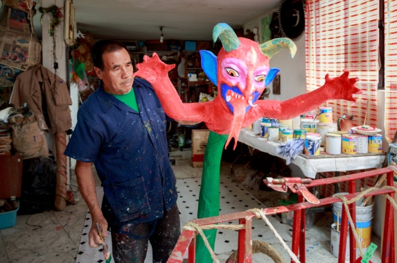Pedro Linares' son Felipe stands beside his Judas sculpture in the family's shop in Mexico City.